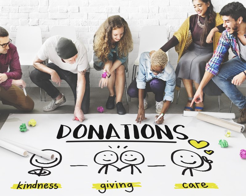 Group of people creating a donations poster