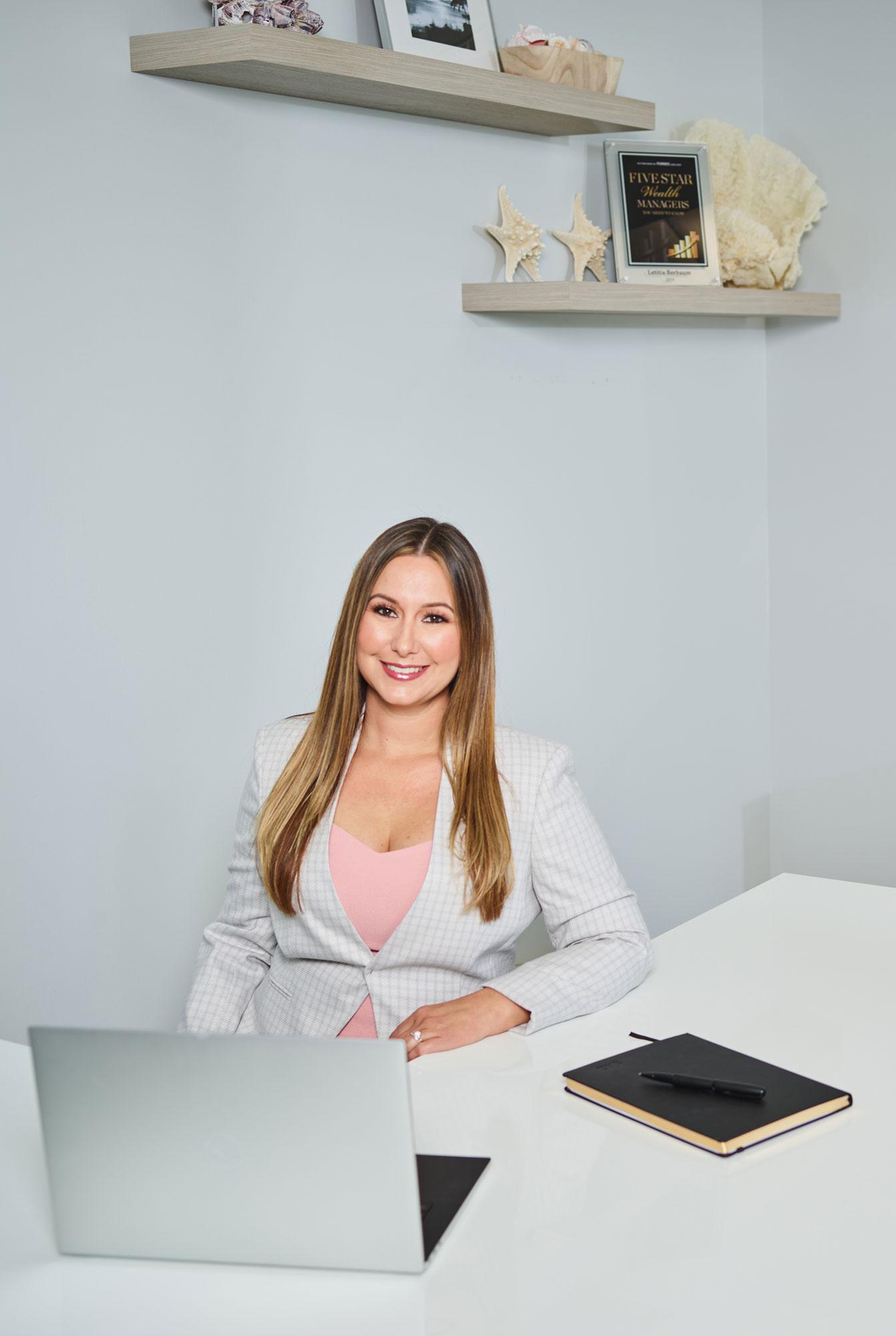 Letitia Berbaum sitting at her desk