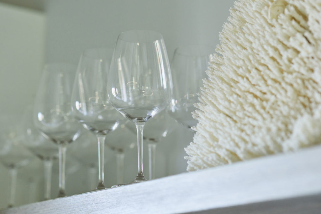 Wine Glasses and Coral on Office Shelf